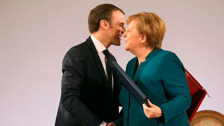 French President Emmanuel Macron and German Chancellor Angela Merkel shake hands after signing a French-German friendship treaty, on January 22, 2019 in the town hall of Aachen, western Germany. - France and Germany signed a new friendship treaty seeking to boost an alliance at the heart of the European Union as Britain bows out and nationalism advances around the continent. (Photo by Ludovic MARIN / AFP)        (Photo credit should read LUDOVIC MARIN/AFP/Getty Images)