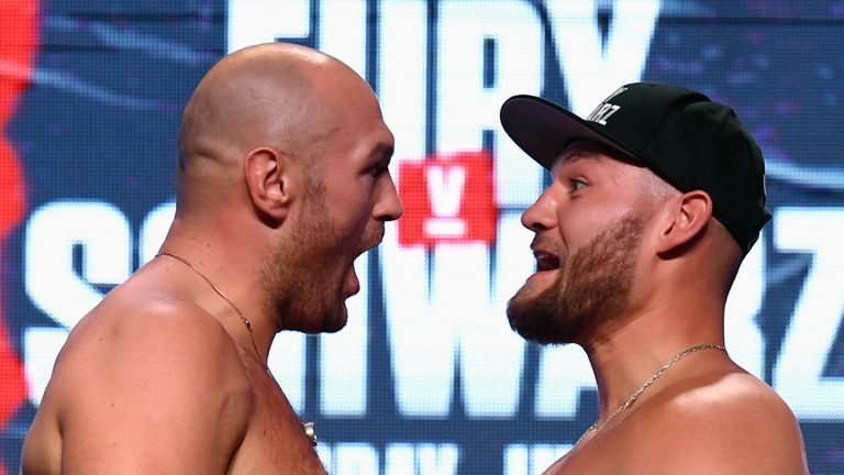 LAS VEGAS, NEVADA - JUNE 14:  Boxers Tyson Fury (L) and Tom Schwarz face off during a ceremonial weigh-in at MGM Grand Garden Arena on June 14, 2019 in Las Vegas, Nevada. The two will meet in a heavyweight bout on June 15 at MGM Grand Garden Arena in Las Vegas.  (Photo by Ethan Miller/Getty Images)