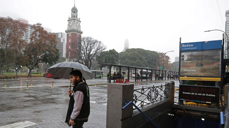 A man walks next to a closed subway station in downtown Buenos Aires on June 16, 2019 during a power cut. - A massive outage blacked out Argentina and Uruguay Sunday, leaving both South American countries without electricity, power companies said. (Photo by ALEJANDRO PAGNI / AFP)        (Photo credit should read ALEJANDRO PAGNI/AFP/Getty Images)