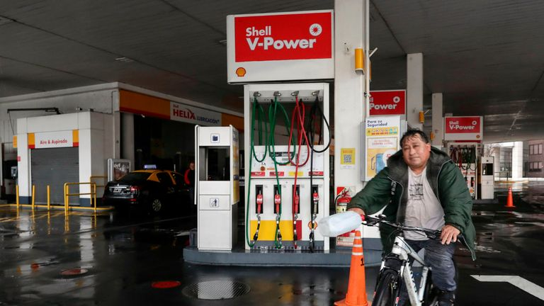 A man rides his bicycle at a closed gas station in downtown Buenos Aires on June 16, 2019 during a power cut. - A massive outage blacked out Argentina and Uruguay Sunday, leaving both South American countries without electricity, power companies said. (Photo by ALEJANDRO PAGNI / AFP)        (Photo credit should read ALEJANDRO PAGNI/AFP/Getty Images)