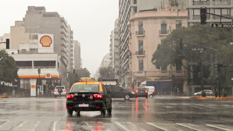 Cars drive past blacked-out traffic signals at the 9 de Julio avenue during a power cut in Buenos Aires on June 16, 2019. - A massive outage blacked out Argentina and Uruguay Sunday, leaving both South American countries without electricity, power companies said. (Photo by ALEJANDRO PAGNI / AFP)        (Photo credit should read ALEJANDRO PAGNI/AFP/Getty Images)