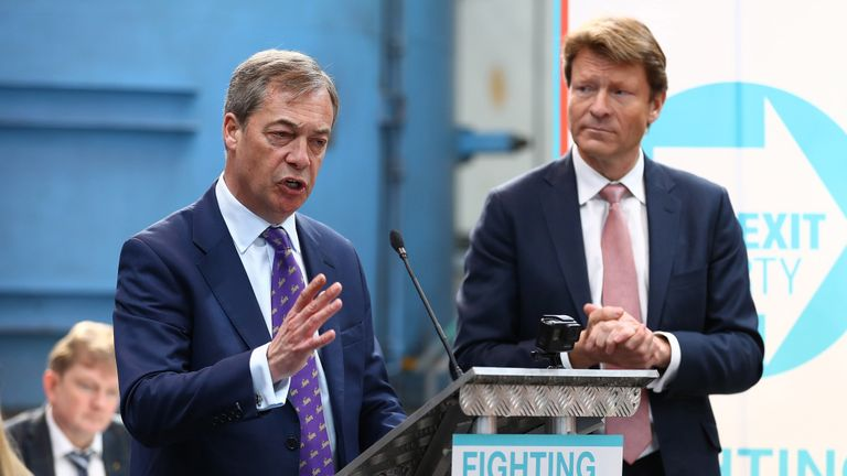 COVENTRY, ENGLAND - APRIL 12: Richard Tice (R) listens as Nigel Farage  speaks during the launch of the Brexit Party at BG Penny & Co on April 12, 2019 in Coventry, England. Former UKIP leader Nigel Farage has launched the Brexit Party ahead of the European Parliamentary elections, which will take place in May. The launch comes after British Prime Minister Theresa May was granted another extension to the Brexit deadline. (Photo by Matthew Lewis/Getty Images)