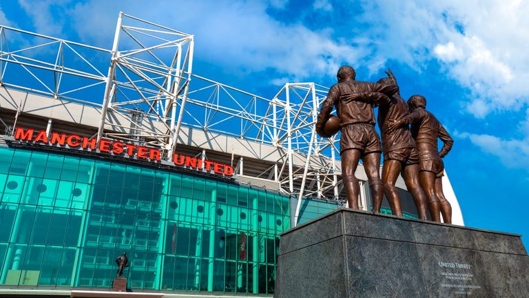 Manchester, UK - May 19 2018: The United Trinity bronze sculpture which composed with George Best, Denis Law and Sir Bobby Charlton in front of Old Trafford stadium