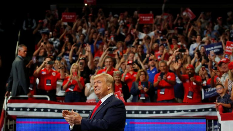 U.S. President Donald Trump reacts on stage formally kicking off his re-election bid with a campaign rally in Orlando, Florida, U.S., June 18, 2019.  REUTERS/Carlos Barria