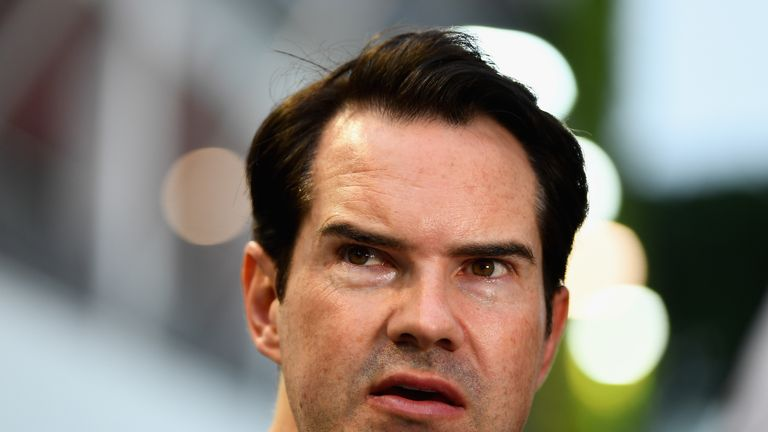 SINGAPORE - SEPTEMBER 16:  British comedian Jimmy Carr looks on in the Paddock before the Formula One Grand Prix of Singapore at Marina Bay Street Circuit on September 16, 2018 in Singapore.  (Photo by Clive Mason/Getty Images)