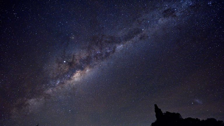 The Milky Way's Galactic Centre, Jupiter (brightest spot in the centre-left of the image) and the Small Magellanic Cloud (SMC) galaxy (right bottom corner) are seen late on May 10, 2019 from the Uruguayan countryside in the department of Soriano, near the village of Andresito, department of Flores. (Photo by Mariana SUAREZ / AFP)        (Photo credit should read MARIANA SUAREZ/AFP/Getty Images)