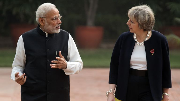 NEW DELHI, INDIA - NOVEMBER 07:  British Prime Minister Theresa May and  Indian Prime Minister Narendra Modi walk through the gardens of Hyderabad House, on November 7, 2016 in New Delhi, India. Theresa May is on a mission to reconnect the UK with the Commonwealth during her first trip to India since taking office, and will be discussing trade.  (Photo by Dan Kitwood/Getty Images)