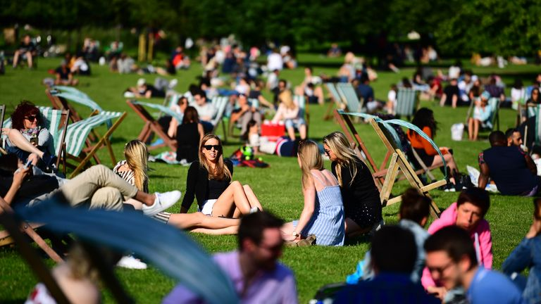 People enjoying the hot weather in St James's Park in London.
