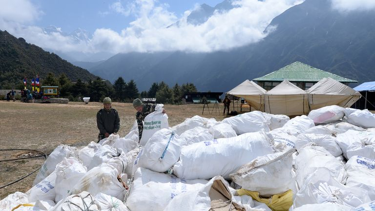 Nepali Army personnel arrange bags of waste collected from the Mount Everest at Namche Bazar in Solukhumbu district on May 27, 2019, before it is transported to Kathmandu to be recycled. - Nepal government sent a dedicated clean-up team to Mount Everest this season with a target to bring back 10,000 kilograms (10 tonnes) of trash in an ambitious plan to clean the world's highest rubbish dump. (Photo by PRAKASH MATHEMA / AFP)        (Photo credit should read PRAKASH MATHEMA/AFP/Getty Images)