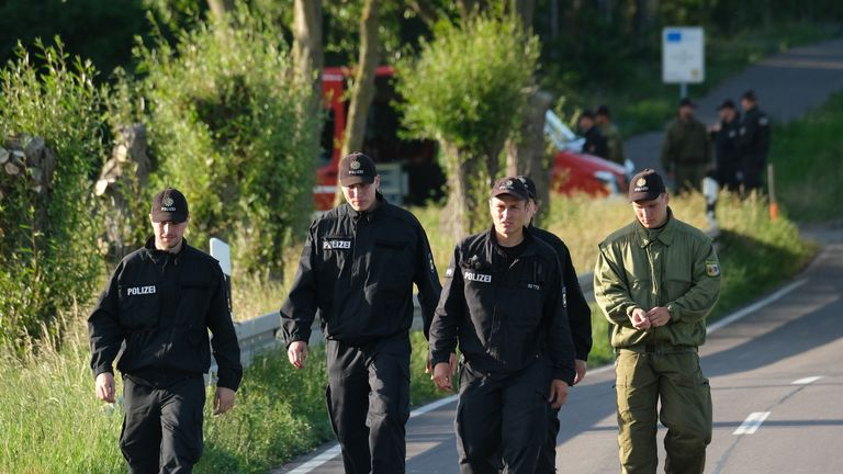NOSSENTIN, GERMANY - JUNE 24: Police walk along the road leading to the crash site of one of two Bundeswehr Eurofighter fighter jets on June 24, 2019 near Nossentin, Germany. Two Eurofighters collided during training earlier today, leaving one pilot dead. (Photo by Sean Gallup/Getty Images)