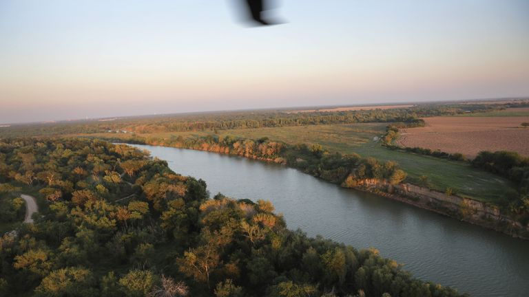 MCALLEN, TX - NOVEMBER 06:  The Rio Grande flows along the U.S.-Mexico border at dusk, as seen from a U.S. Air and Marine Operations helicopter patrol on November 6, 2018 in McAllen, Texas. The border line between Mexico (R), and the United States falls in the middle of the river through the southern length of Texas.  (Photo by John Moore/Getty Images)