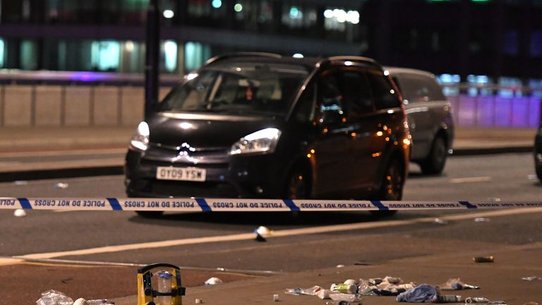 TOPSHOT - Debris and abandoned cars remain on London Bridge at the scene of an apparent terror attack in central London on June 3, 2017. Armed police fired shots after reports of stabbings and a van hitting pedestrians on London Bridge on Saturday in an incident reminiscent of a terror attack in March just days ahead of a general election. / AFP PHOTO / Chris J Ratcliffe        (Photo credit should read CHRIS J RATCLIFFE/AFP/Getty Images)