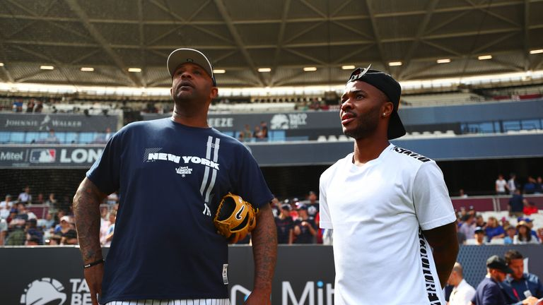LONDON, ENGLAND - JUNE 28:  Raheem Sterling of England and Manchester City speaks with CC Sabathia #52 of the New York Yankees on the field during previews ahead of the MLB London Series games between Boston Red Sox and New York Yankees at London Stadium on June 28, 2019 in London, England. (Photo by Dan Istitene/Getty Images)