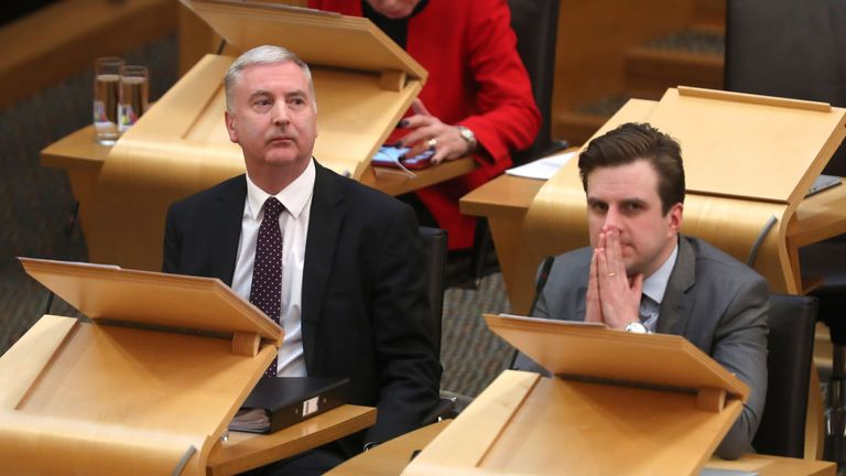 Labour MSP James Kelly and Daniel Johnson (right) during a debate on the Offensive Behaviour at Football and Threatening Communications (Scotland) Act, in the debating chamber at the Scottish Parliament in Edinburgh.