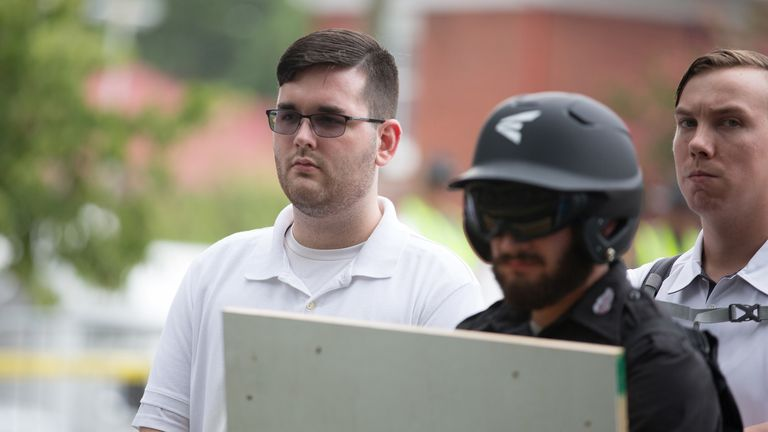 "James Alex Fields Jr., (L) is seen attending the ""Unite the Right"" rally in Emancipation Park before being arrested by police and charged with charged with one count of second degree murder, three counts of malicious wounding and one count of failing to stop at an accident that resulted in a death after police say he drove a car into a crowd of counter-protesters later in the afternoon in Charlottesville, Virginia, U.S., August 12, 2017. Picture taken August 12, 2017  REUTERS/Eze Amos"