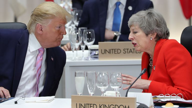 Britain's Prime Minister Theresa May speaks with U.S. President Donald Trump during the G20 summit in Osaka, Japan June 28, 2019. Sputnik/Mikhail Klimentyev/Kremlin via REUTERS  ATTENTION EDITORS - THIS IMAGE WAS PROVIDED BY A THIRD PARTY.