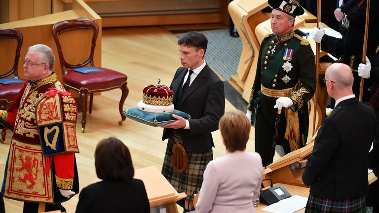 EDINBURGH, SCOTLAND - JUNE 29: Alexander Douglas Douglas-Hamilton, 16th Duke of Hamilton and the Premier Peer of Scotland, delivers the Scots Crown to parliament as Queen Elizabeth II, accompanied by Prince Charles, who is known as the Duke of Rothesay when in Scotland, attends a ceremony to mark the 20th Anniversary of the Scottish Parliament on June 29, 2019 in Edinburgh, Scotland. The ceremony took place almost two decades to the day since the Scottish Parliament officially assumed its legal powers. (Photo by Jeff J Mitchell/Getty Images)