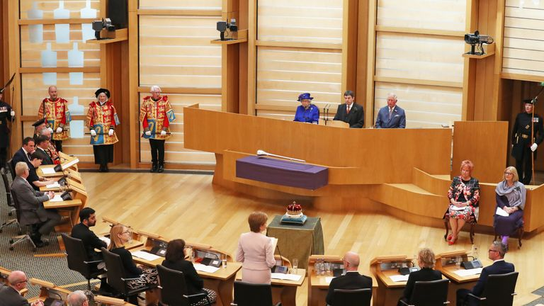 Queen Elizabeth II and the Duke of Rothesay listen as First Minister Nicola Sturgeon makes a speech during a ceremony marking the 20th anniversary of devolution in the Holyrood chamber at the Scottish Parliament in Edinburgh.