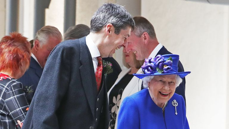 Queen Elizabeth II is greeted by Presiding Officer of the Scottish Parliament Ken Macintosh as she arrives at the Scottish Parliament in Edinburgh ahead of giving a speech to MSPs in the Holyrood chamber during a ceremony marking the 20th anniversary of devolution.