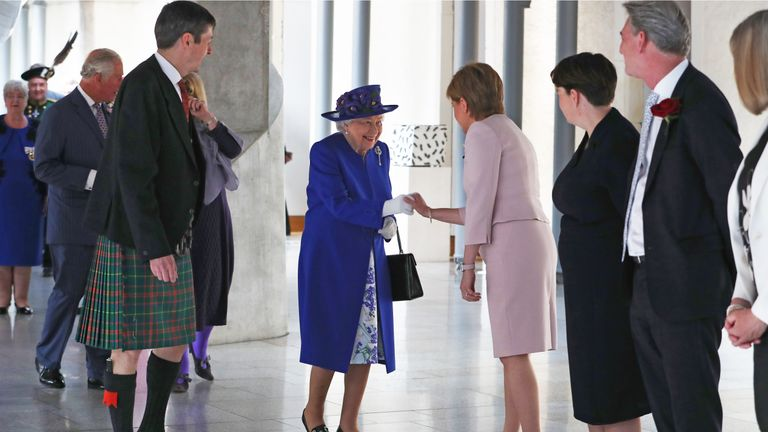 Queen Elizabeth II is greeted by First Minister Nicola Sturgeon as she arrives at the Scottish Parliament in Edinburgh ahead of giving a speech to MSPs in the Holyrood chamber during a ceremony marking the 20th anniversary of devolution.