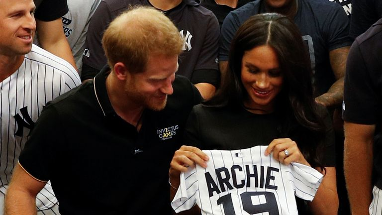 LONDON, ENGLAND - JUNE 29:   Prince Harry, Duke of Sussex and Meghan, Duchess of Sussex with a gift from the New York Yankees before their game against the  Boston Red Sox \at London Stadium on June 29, 2019 in London, England. The game is in support of the Invictus Games Foundation. (Photo by Peter Nicholls - WPA Pool/Getty Images)