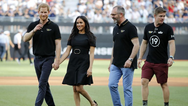 Britain's Prince Harry, Duke of Sussex and Britain's Meghan, Duchess of Sussex arrive on the field prior to the start of the first of a two-game series between  the New York Yankees and the Boston Red Sox at London Stadium in Queen Elizabeth Olympic Park, east London on June 29, 2019. - As Major League Baseball prepares to make history in London, New York Yankees manager Aaron Boone and Boston Red Sox coach Alex Cora are united in their desire to make the ground-breaking trip memorable on and off the field. (Photo by Tolga AKMEN / AFP)        (Photo credit should read TOLGA AKMEN/AFP/Getty Images)