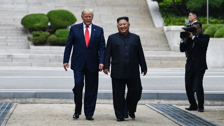 North Korea's leader Kim Jong Un walks with US President Donald Trump north of the Military Demarcation Line that divides North and South Korea, in the Joint Security Area (JSA) of Panmunjom in the Demilitarized zone (DMZ) on June 30, 2019. (Photo by Brendan Smialowski / AFP)        (Photo credit should read BRENDAN SMIALOWSKI/AFP/Getty Images)