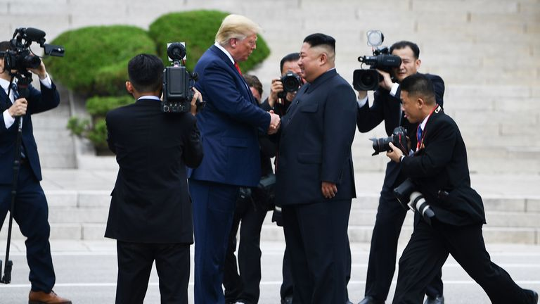 North Korea leader Kim Jong Un greets US President Donald Trump north of the military demarcation line that divides North and South Korea at the Panmunjom Joint Security Area (JSA) in the area. Demilitarized (DMZ) on June 30, 2019. (Photo by Brendan Smialowski / AFP) (Photo credit must be BRENDAN SMIALOWSKI / AFP / Getty Images)