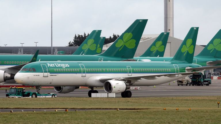 Aer Lingus passenger jets sit on the apron at Dublin Airport in Ireland
