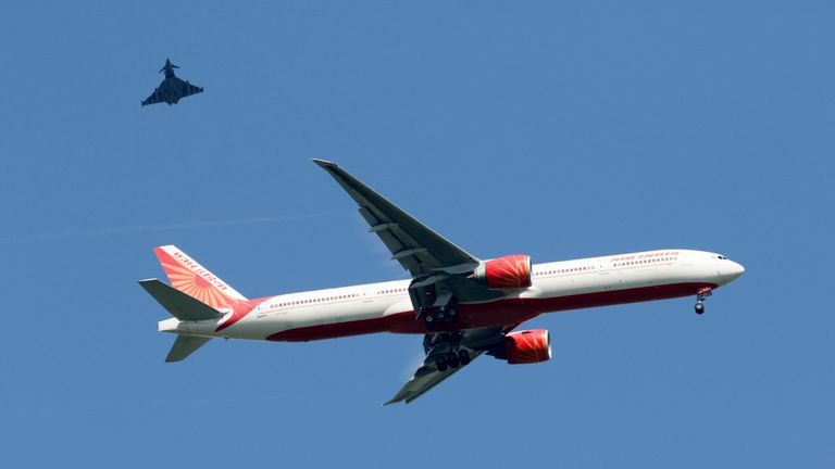 VT-ALK Air India Boeing 777-300 with an RAF Typhoon escort over Sawbridgeworth into Stansted. Pic: Nigel Blake/Alamy