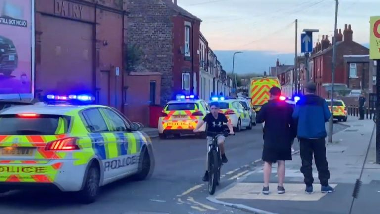 The victims were attacked on Manningham Road in the Anfield area of Liverpool