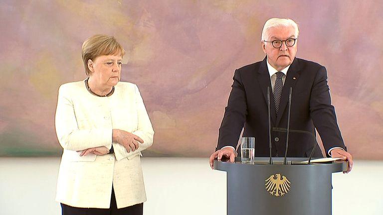 Mrs Merkel was shaking as she stood by German President Frank-Walter Steinmeier