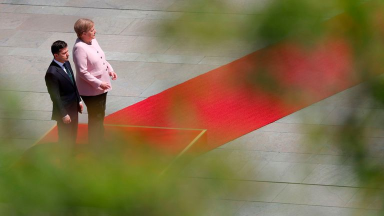 German Chancellor Angela Merkel began shaking while standing next to new Ukrainian President Volodymyr Zelensky