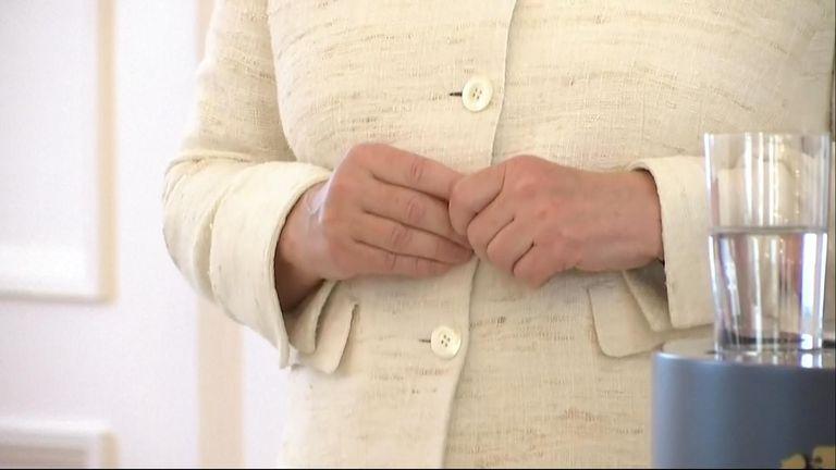 German Chancellor Angela Merkel seen shaking