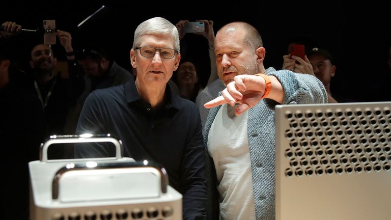Apple CEO Tim Cook, left, and chief design officer Jonathan Ive look at the Mac Pro in the display room at the Apple Worldwide Developers Conference in San Jose, Calif., Monday, June 3, 2019. (AP Photo/Jeff Chiu)