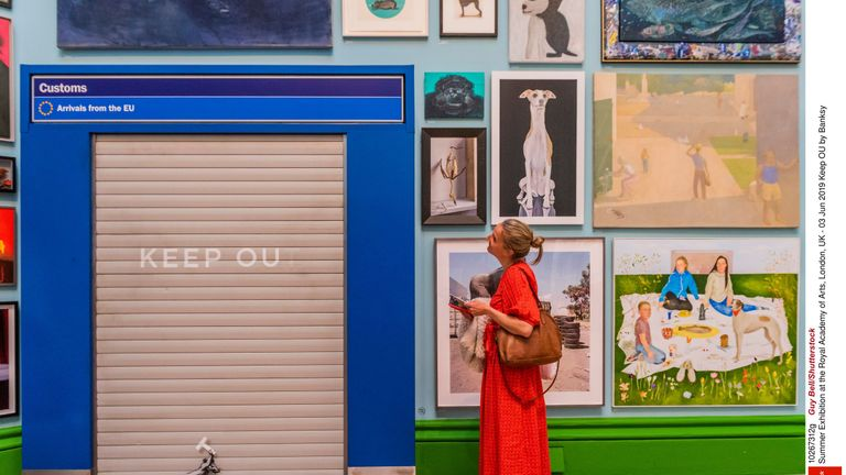 Keep OU by Banksy, from Summer Exhibition at the Royal Academy of Arts, London Pic: Guy Bell/Shutterstock