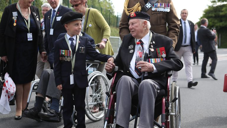 D-Day veteran John Quinn meets George Sayer, 6, in Bayeux, France on the 75th anniversary of the D-Day landings