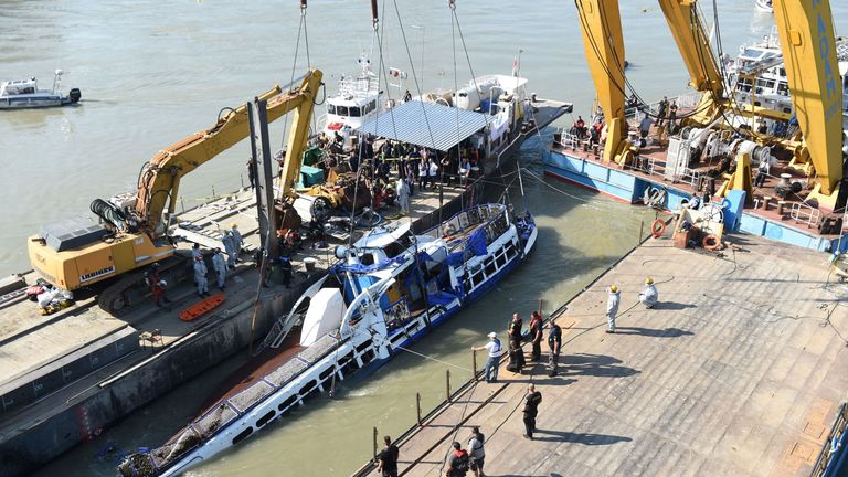 Four more bodies found as sunken tour boat lifted from Danube river