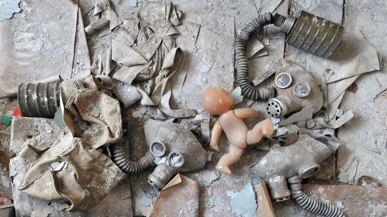 A doll and gas masks are pictured on a bed in one of the kindergarten of the ghost city of Pripyat on April 18, 2011. In the heart of Chernobyl, Ukrainian specialists regularly venture inside the concrete cover sheltering the ruined reactor after it exploded on April 26, 1986 to check its structure and radiation levels. / AFP / SERGEI SUPINSKY AND - (Photo credit should read SERGEI SUPINSKY/AFP/Getty Images)