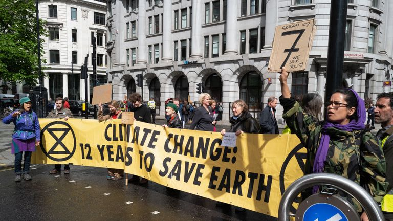 "Environmental campaigners from the ""Extinction Rebellion"" group block the junction near the Bank of England as part of their ongoing actions and protests across the capital on April 25, 2019 in London, England."