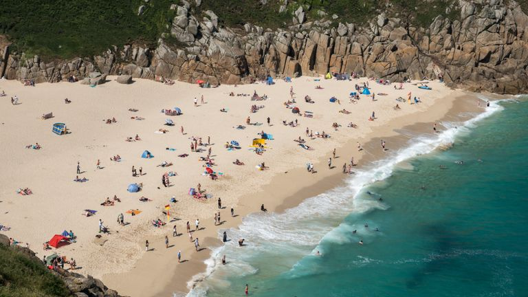 People enjoy the heatwave on Porthcurno Beach near Penzance in Cornwall, England, on 28 June