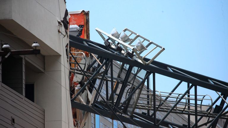 Crane collapses during storm and 'slices through' apartments