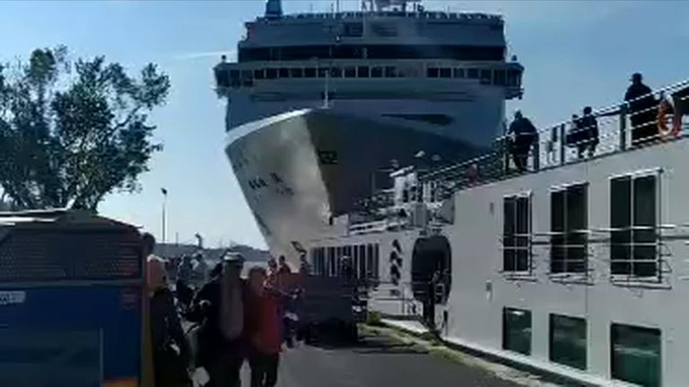 Terrifying video emerged of people fleeing as the ship approaches the dock