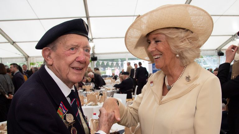 Ronald Wilson, 94, greets the Duchess of Cornwall at a reception after the service in Bayeux
