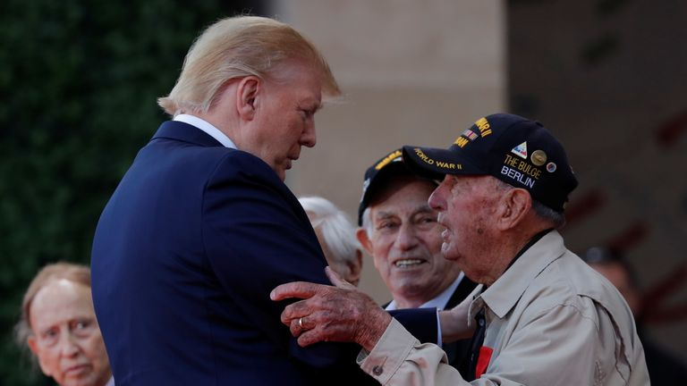 Donald Trump greets WWII veterans during the commemoration ceremony for the 75th anniversary of D-Day at the American cemetery of Colleville-sur-Mer in Normandy