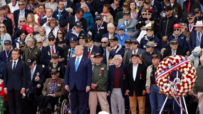 Emmanuel Macron and Donald Trump stand during a ceremony to mark the 75th anniversary of the D-Day at the Normandy American Cemetery and Memorial in Colleville-sur-Mer, France
