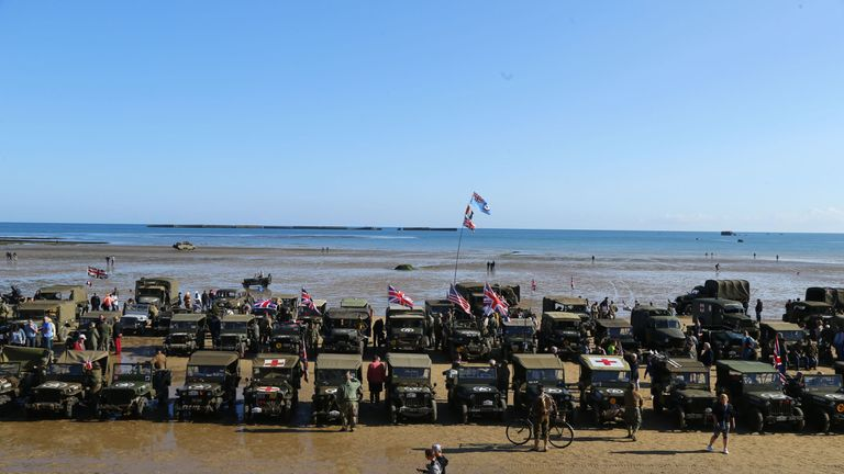 Military vehicles line the beach at Arromanches in Normandy