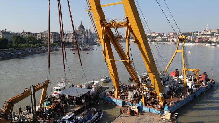 The boat which sank in the Danube river in Budapest is lifted from the water