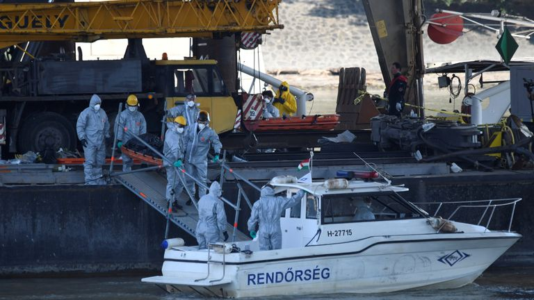 Salvage crews are seen during an operation to raise the sunken tourist boat