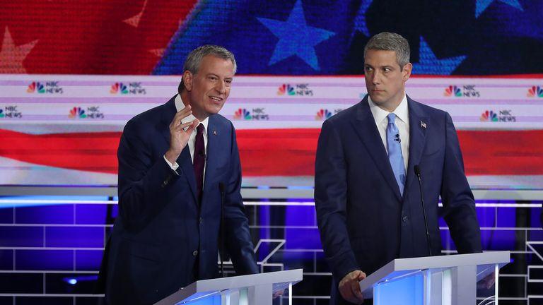New York City Mayor Bill de Blasio (L) and Tim Ryan at the debate